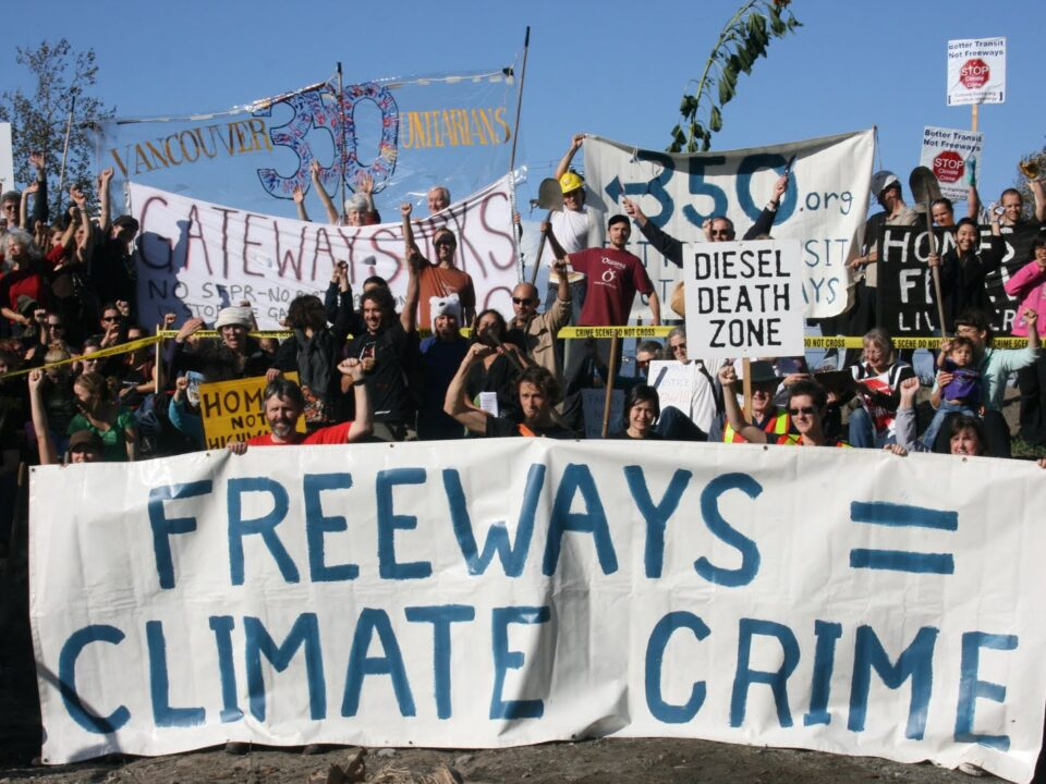 Demonstration with Freeways = Climate Crime banner